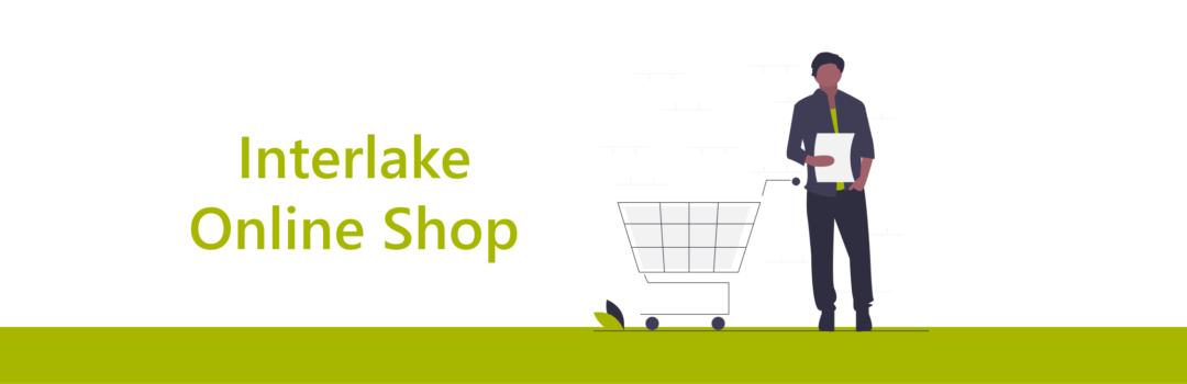 Illustration, Einkaufswagen mit Mann, Text Interlake Online Shop